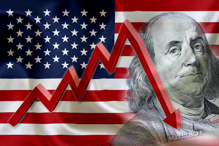 US flag, 100 dollar bill, and a downward arrow - graphic - 12th October 2018